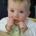 baby flossing teeth
